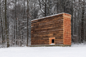 John Pawson builds Wooden Chapel for cyclists from huge logs