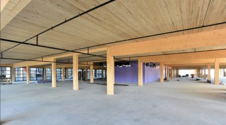 In Midtown, a wood-frame office building rises