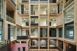 Drone footage reveals 10-storey timber atrium by Studio RH