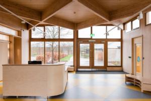 DK-CM unites post-war and 1990s schools with CLT reception pavilion
