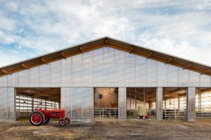 """La Shed Architecture creates translucent barn to give cows """"a better quality of life"""""""